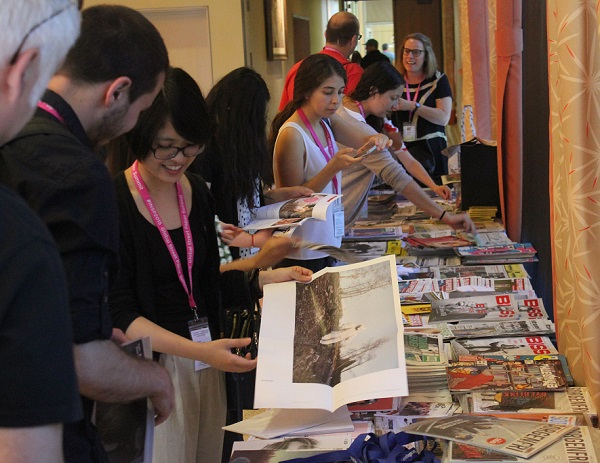 Global Street Paper Summit delegates browse street papers.