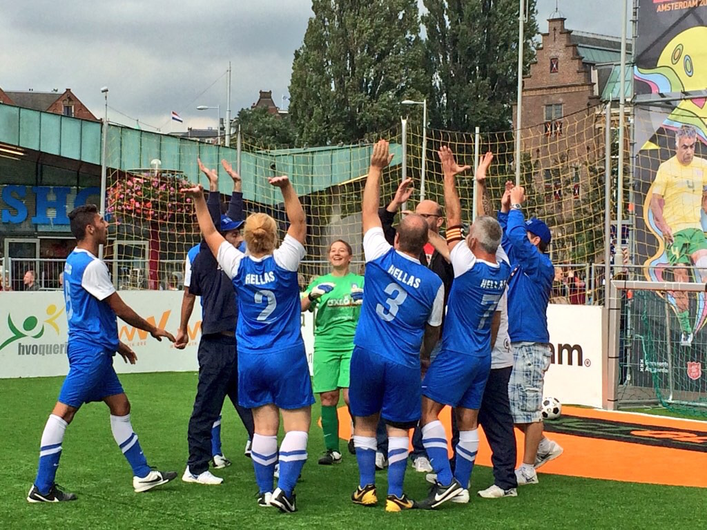 Team Shedia celebrate a win at the Homeless World Cup. Photo: Laura Smith