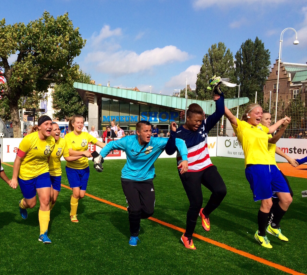 Team Sweden and USA celebrate after their match at the Homeless World Cup. Photo: Laura Smith