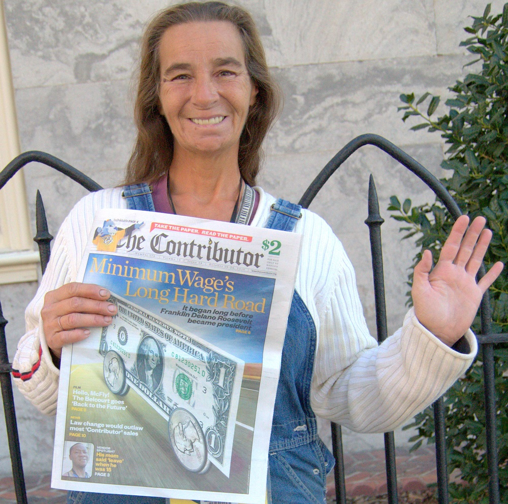 Elaine P selling The Contributor with a smile