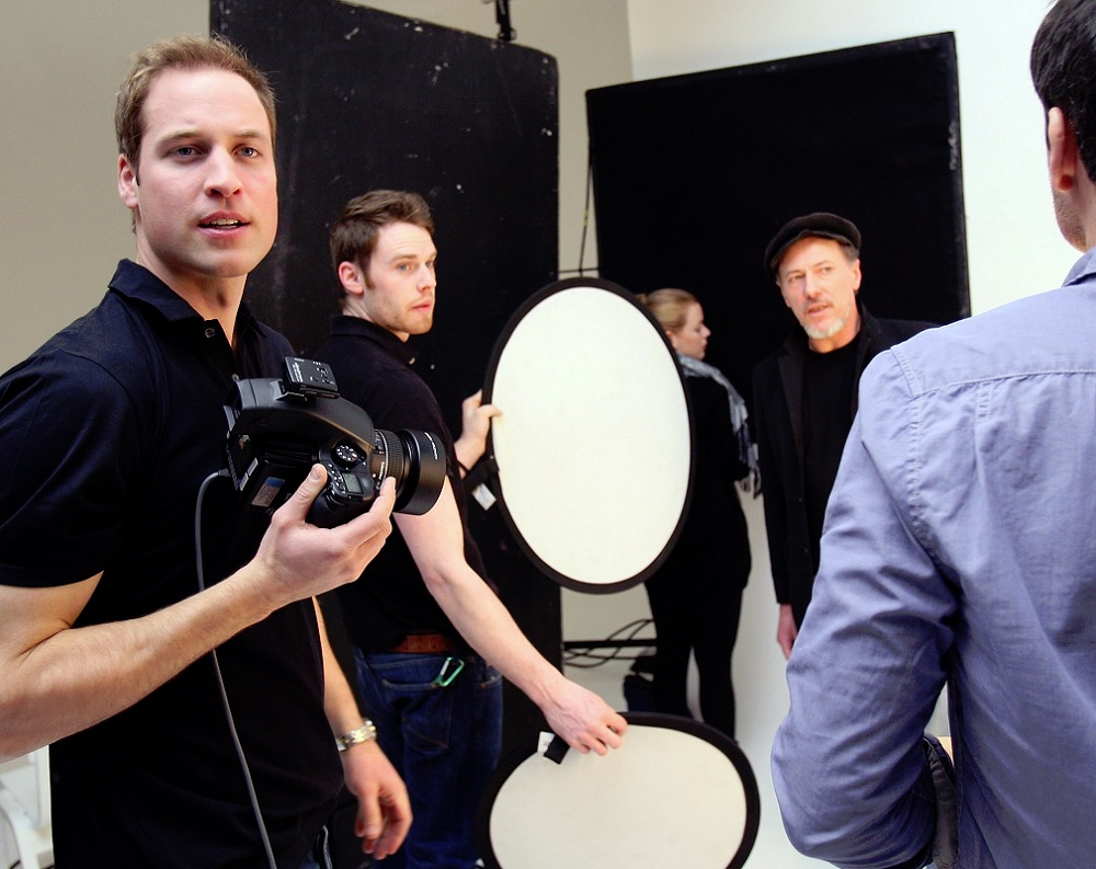 Prince William and Jeff Hubbard, a formerly homeless man and client of Crisis, create a dyptich for 'A Positive View' exhibition at Somerset House in March 2010. Photo: A. G. Carrick, Chris Jackson via Getty Images