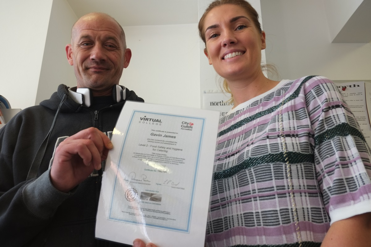 Big Issue North vendor Gavin receives his Food Hygiene Certificate.