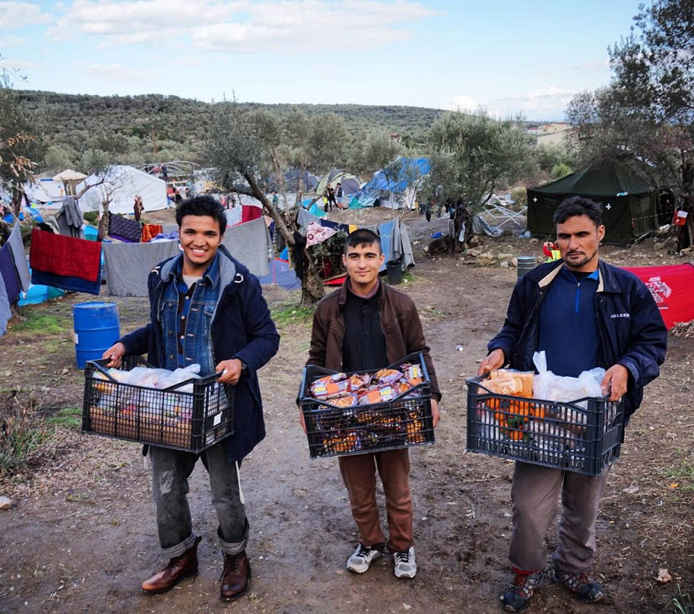 Helping out in the temporary camp. Photo: Colleen Sinsky/Street Roots