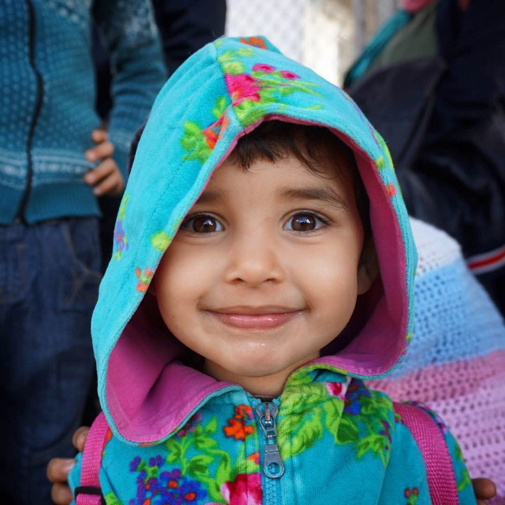 A Syrian child newly arrived on the Greek island of Lesvos. Photo: Colleen Sinsky/Street Roots