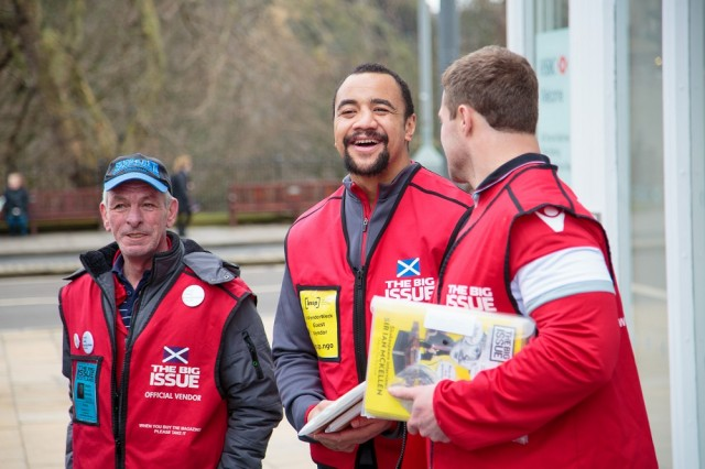 Edinburgh rugby stars Nasi Manu and Allan Dell sell The Big Issue with vendor George. Photo: Euan Ramsay<br>