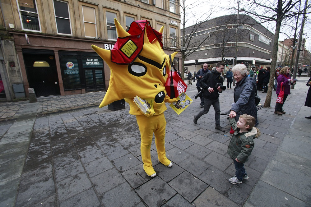 Kingslet attempts to make a sale to a young passerby Photo: Herald and Times