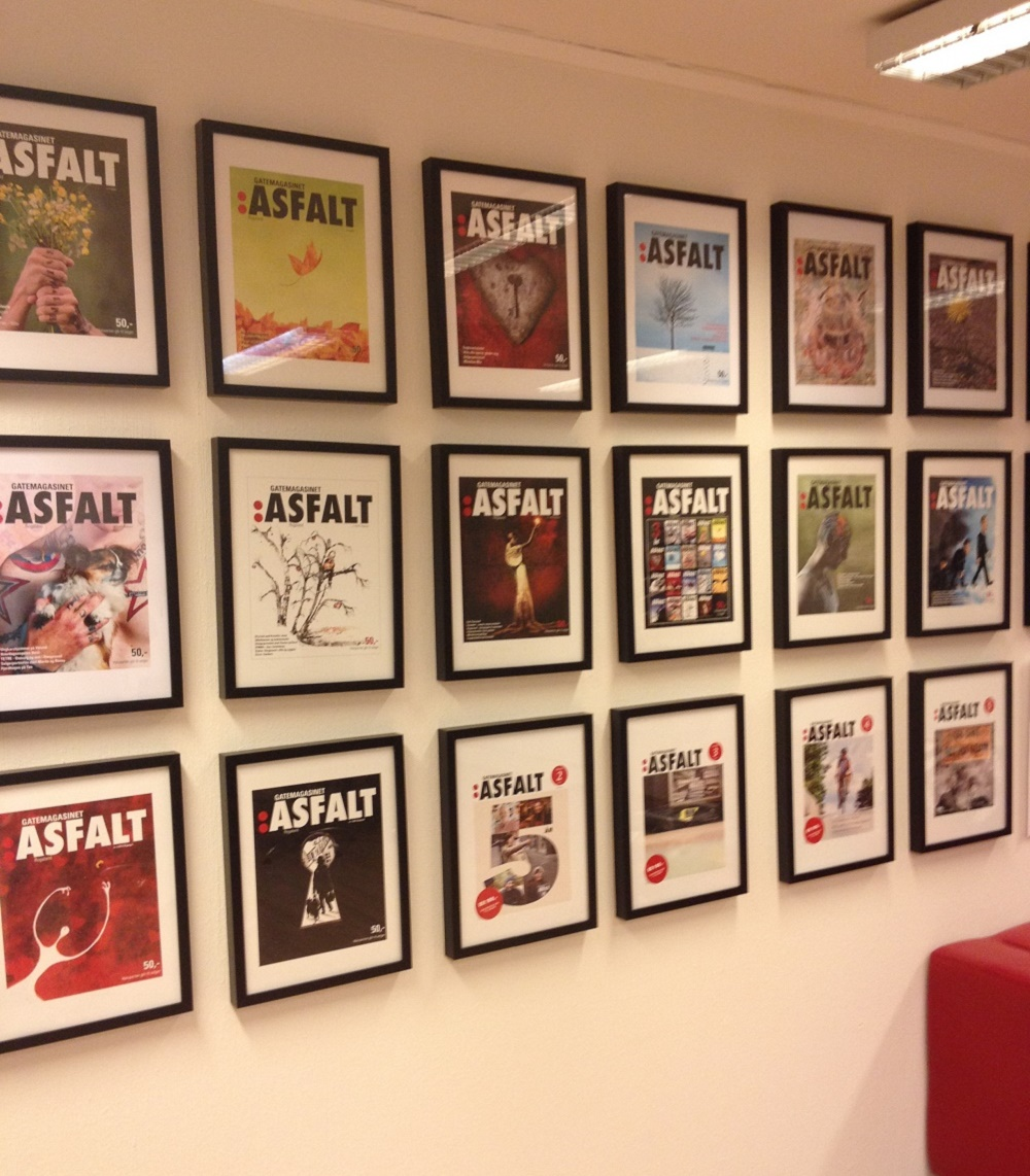 Previous front covers from the street paper Asfalt in thier office. Photo: Alison Gilchrist
