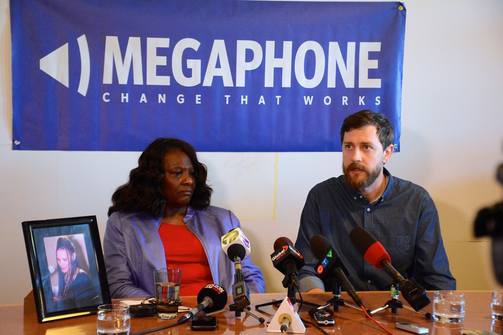 Anita's mother Loretta Sundstrom and Megaphone's executive director Sean Condon speak at a press conference.