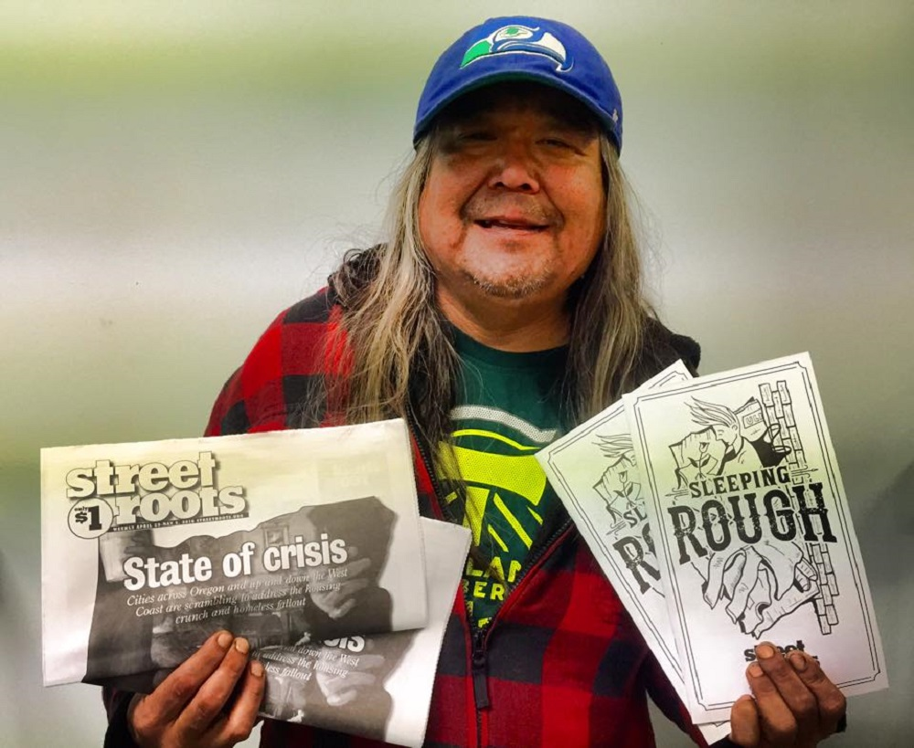 Street Roots vendor Daniel shows off the Sleeping Rough zine