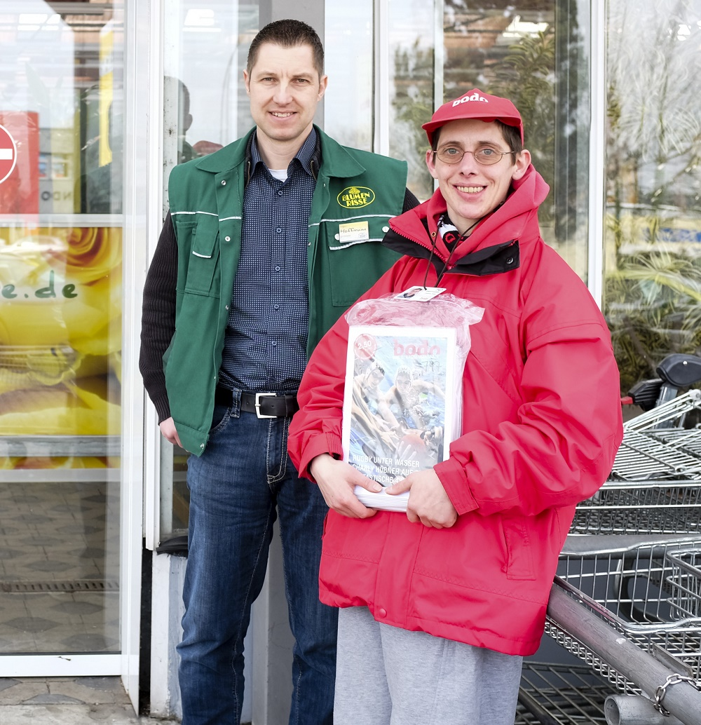 Jessica with Mr Hoffmann, the supermarket manager. Photo: Sebastian Sellhors