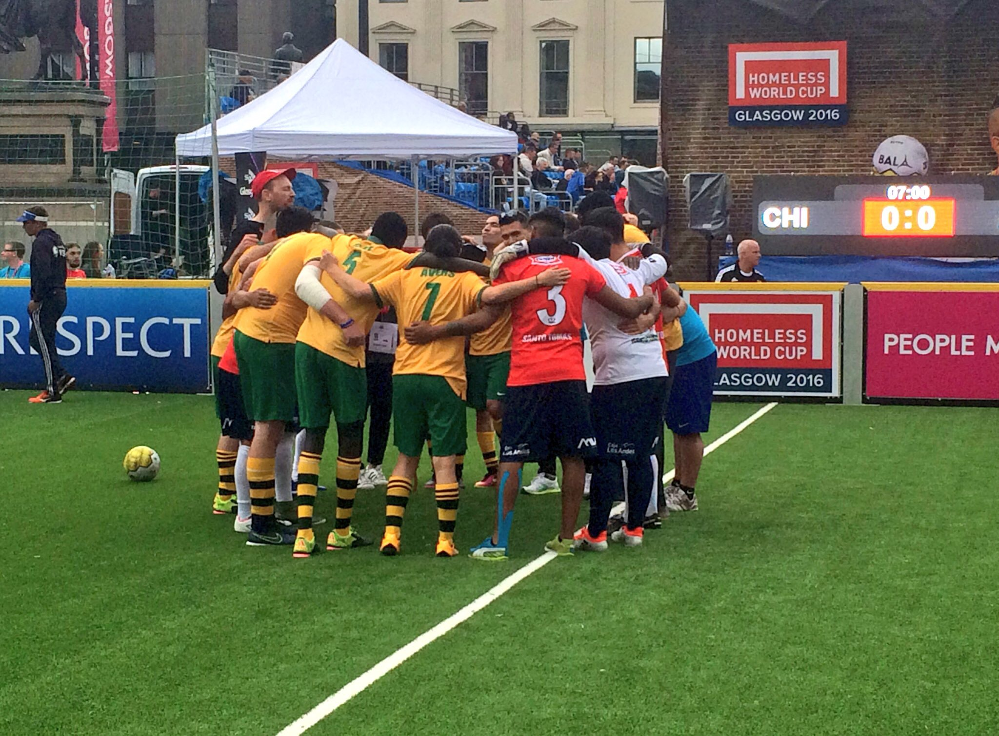 Australia and Chile in a team huddle after their match at the Homeless World Cup in Glasgow.