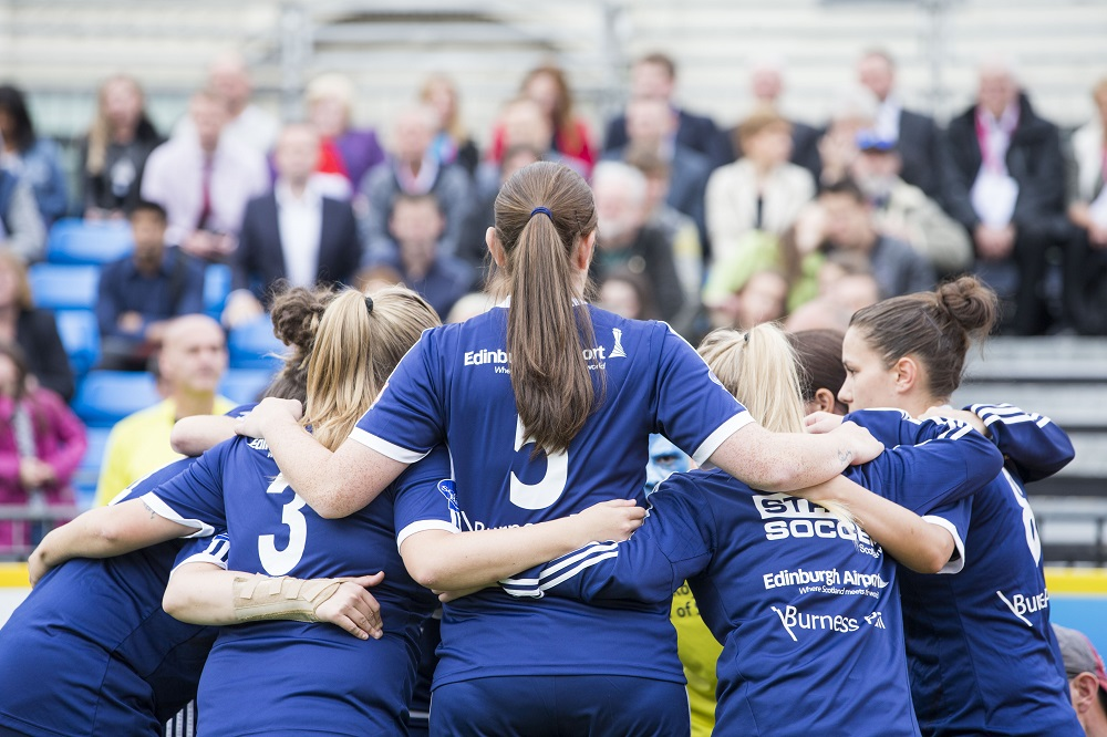 Pre-match team huddle for Team Scotland. Photo: Homeless World Cup