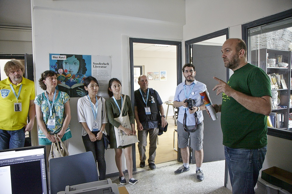 Thiago (2nd right) and other delegates meet Shedia's founder and editor Chris Alefantis (far right) at the paper's offices in Athens. Photo Giannis Zindrilis