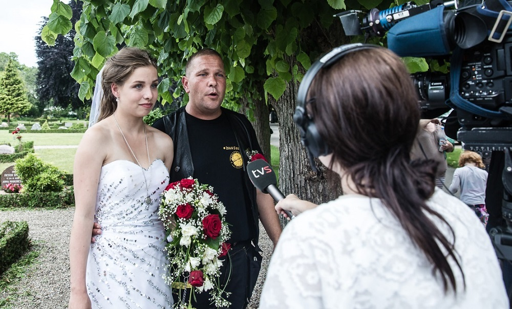 Gilbert and Cappella Frick talking to the media following their wedding ceremony in Vejle, Denmark. Photo: Mette Kramer Kristensen