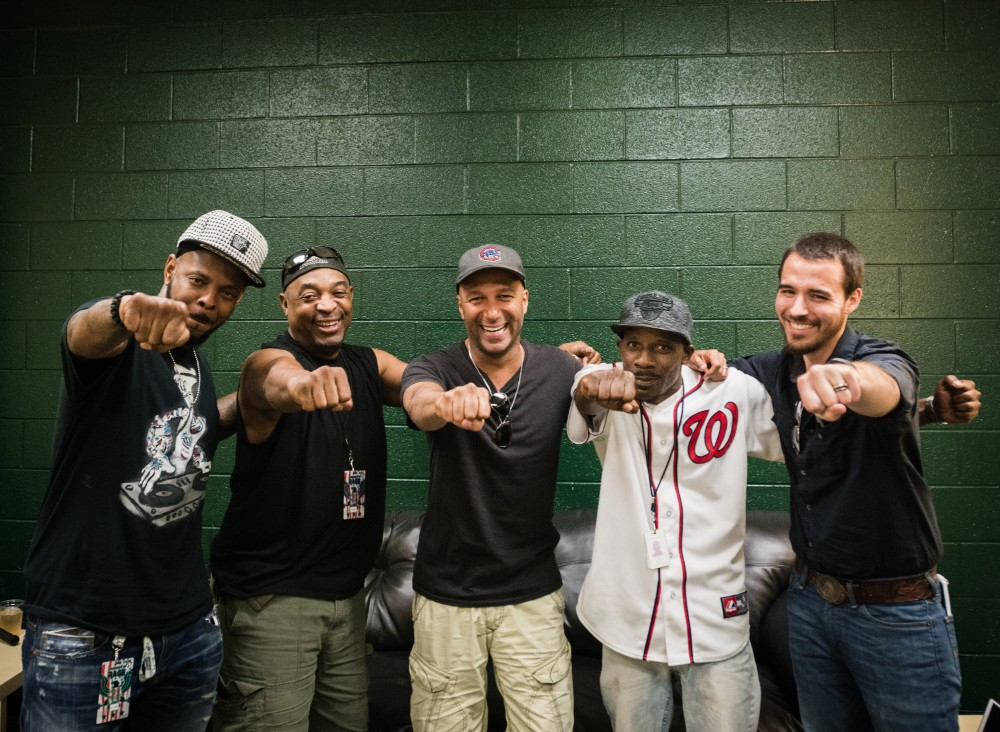 DJ Lord, Chuck D and Tom Morello of Prophets of Rage pictured with Street paper vendor and self-produced rapper Ronald Dudley (a.k.a. Pookanu) and Street Sense editor-in-chief Eric Falquero. Credit: Rodney Choice