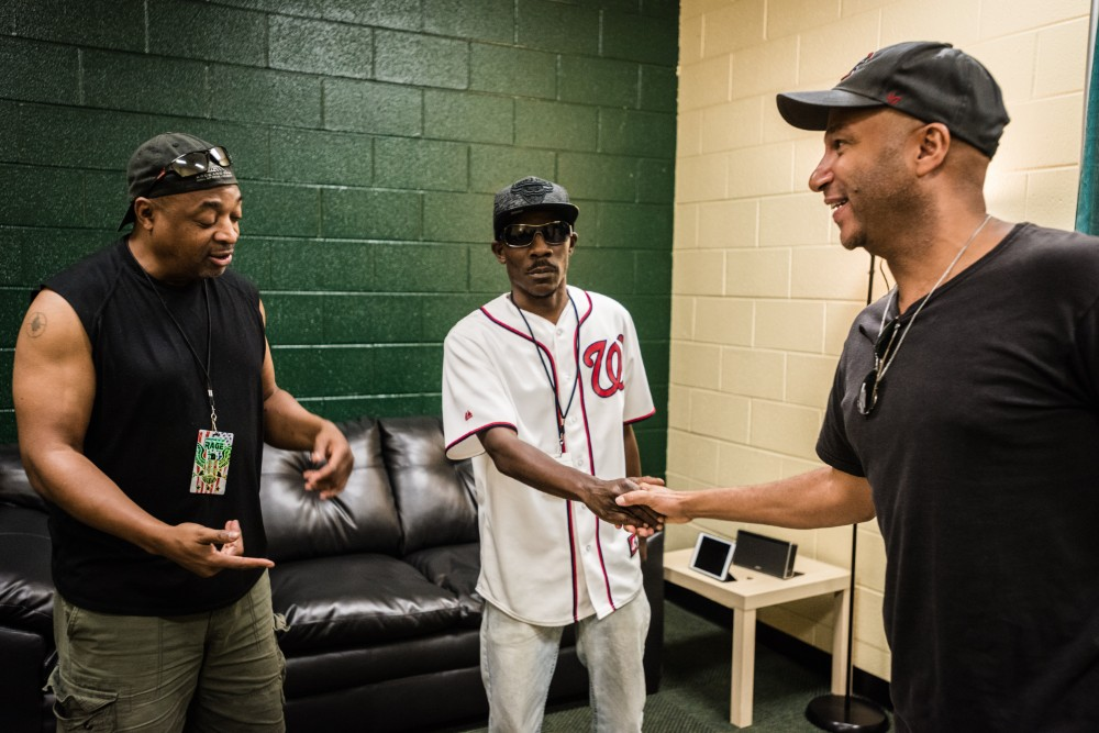 Chuck D (left) and Tom Morello (right) shake hands with Ronald Dudley. Credit: Rodney Choice