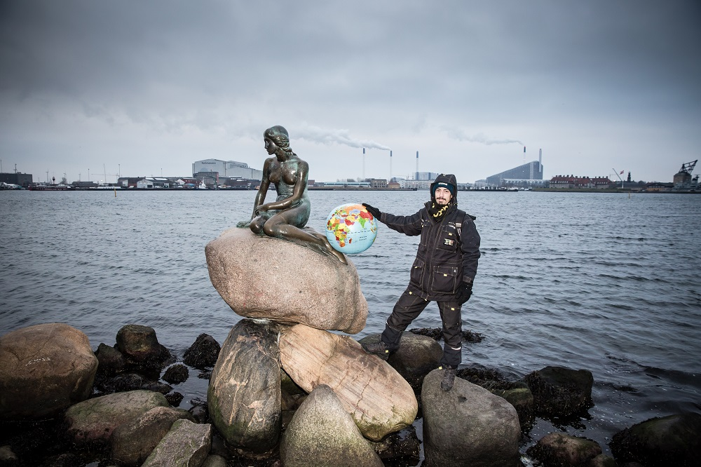 Hus Forbi vendor Wesley pictured at the Little Mermaid statue in the city Credit: Mette Kramer Kristensen
