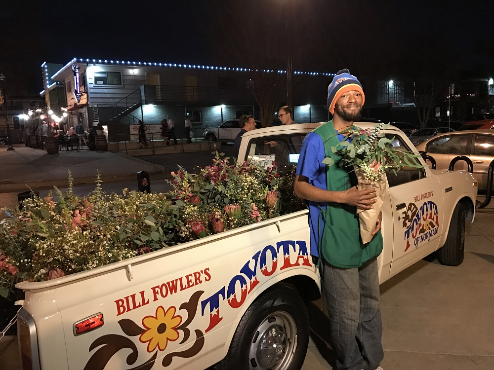 Steven Gage selling bouquets at a night market in Oklahoma City's Plaza District. Credit: Ranya O'Connor