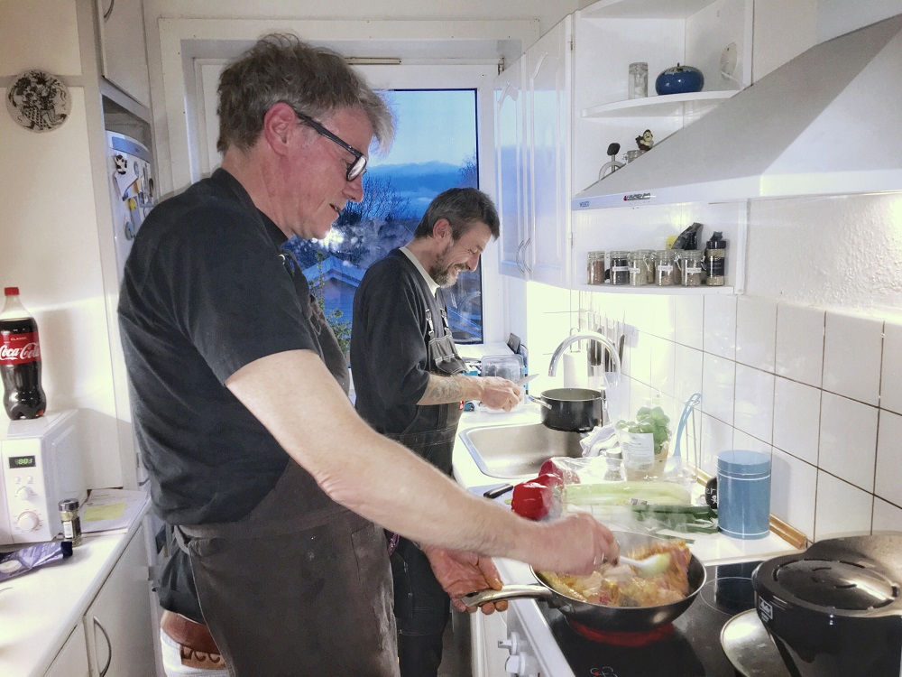 Hus Forbi vendor Kim Olsen, and the magazine's editor Poul Struve Nielsen, cook for one lucky competition winner. Credit: Mette Kramer Kristensen