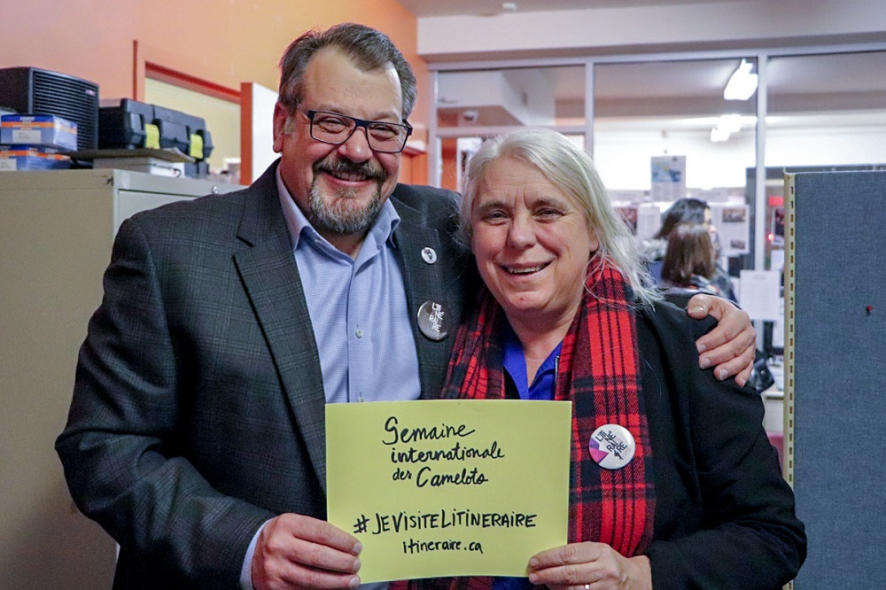 Luc Desjardins, L'Itinéraire's executive director, with Manon Massé, Quebec Solidaire's co-spokeperson and member of Parliament. Credit: Alexandre Duguay.