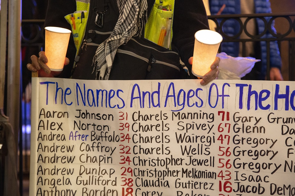 """Just before sunset a group of faith leaders, homeless advocates and formerly homeless people gatthered at the Tree of Life statue remember those who died outside this year. As each of the names were read aloud, the group repeated the phrase """"We Remember."""" (Credit: Matthew S. Browning)"""