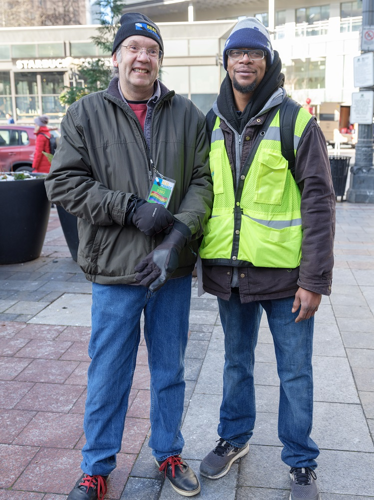 Founding Director of Real Change Tim Harris sold copies of the Seattle street paper during #VendorWeek 2019 while being paired with veteran vendor Michael Dotts. (Credit: Jeff Few)