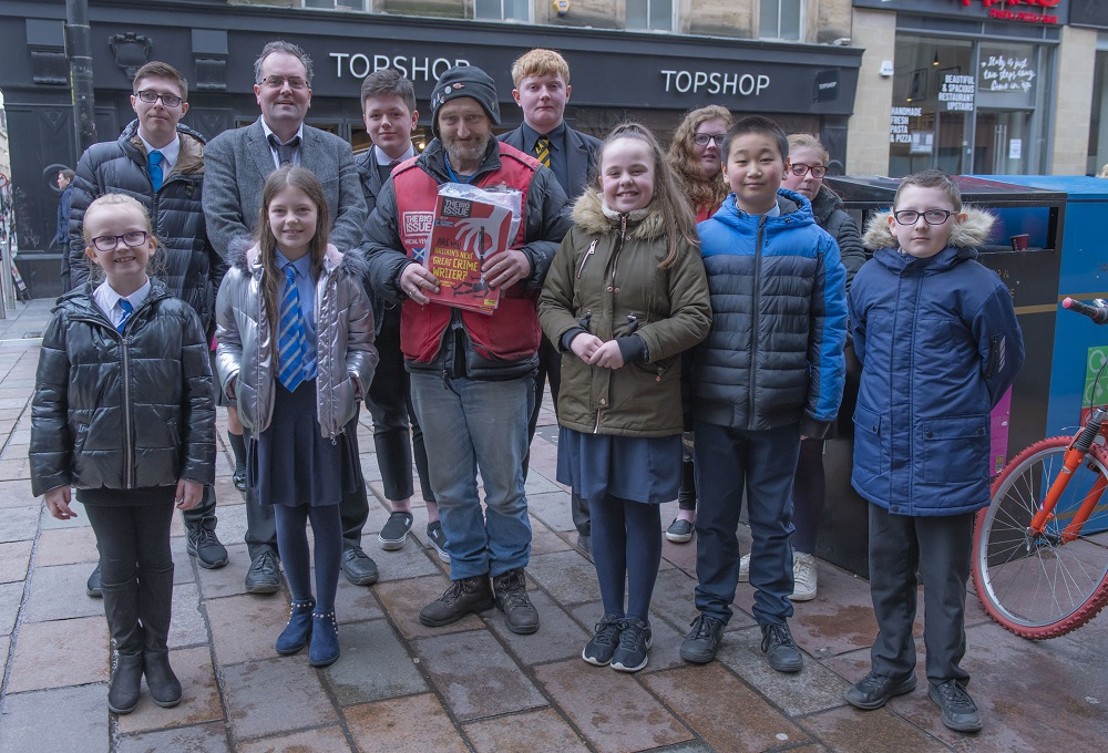 The pupils hear from Big Issue vendor Paul (Credit: Jamie McFadyen)