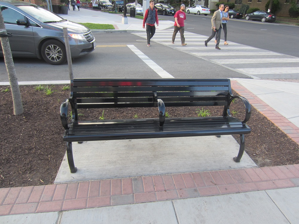 Dividers built in to what benches remain in the city prevent anyone from stretching out and lying down comfortably.. [Credit: Ken Martin]