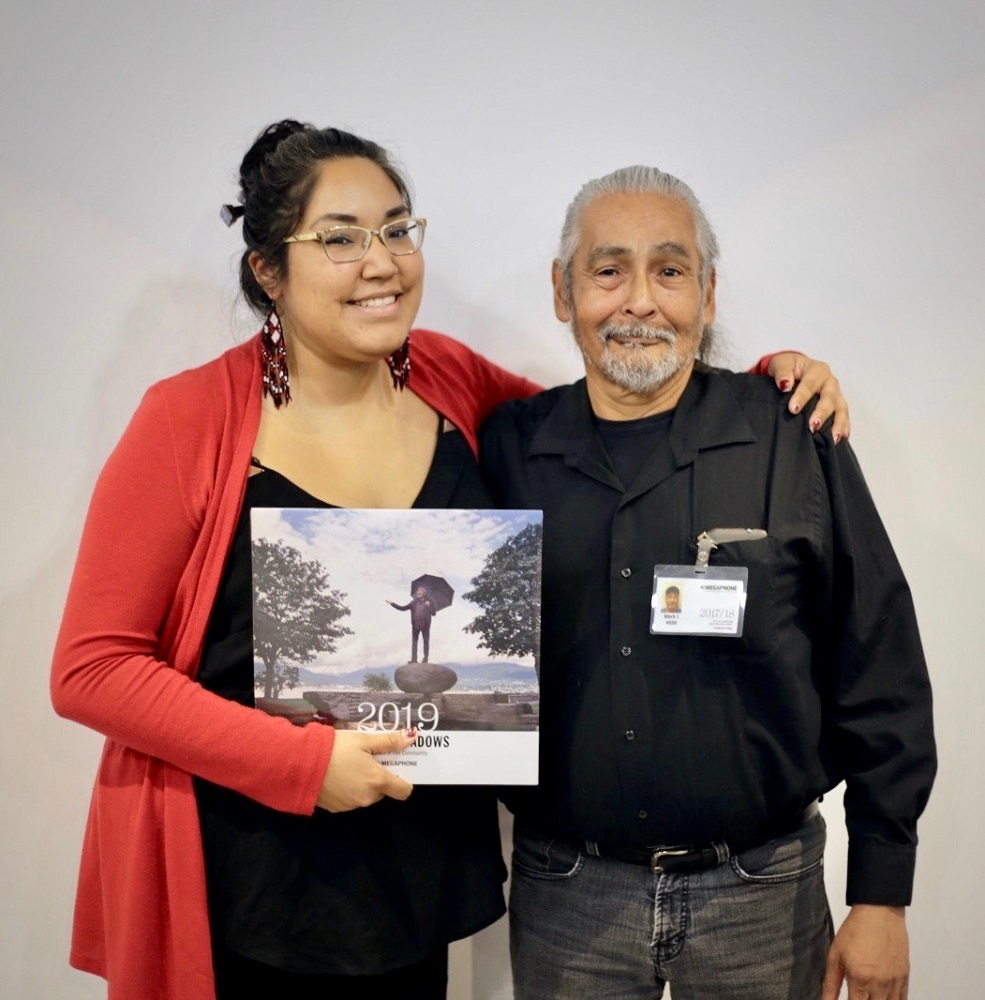 Buffie Irvine and her father Mark Irvine hold a copy of the 2019 Hope in Shadows calendar at the project launch in Vancouver in October. [Credit: Clint Bargen]
