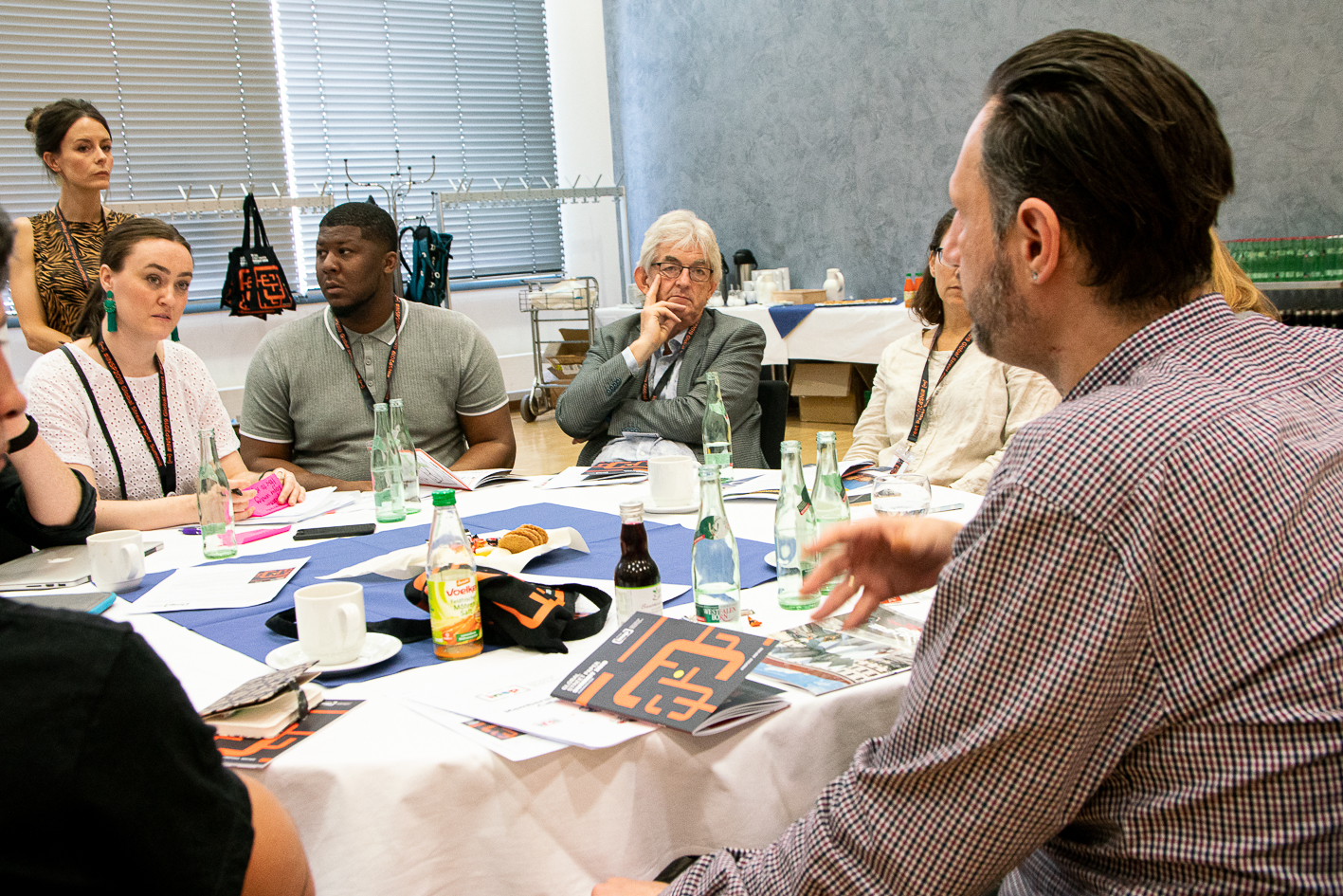 Just like old times: Mel Young participates in delegate discussions earlier in the day. (Credit: Andreas Fuchs)