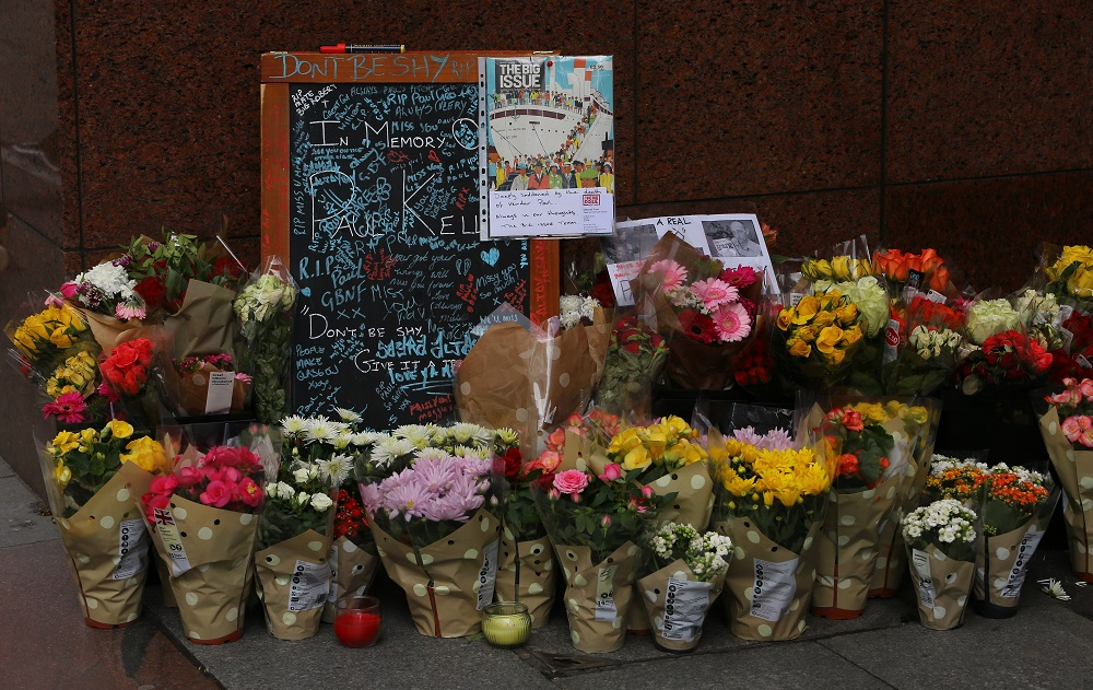 Tributes to Big Issue vendor Paul Kelly near the spot where he sold copies of the Big Issue on Buchanan Street, Glasgow. (Credit: Jamie Simpson/Herald & Times)
