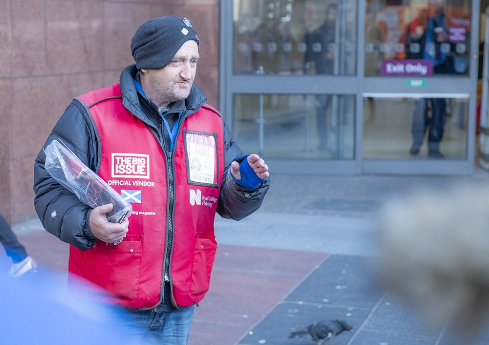 Big Issue vendor Paul Kelly at his pitch in Glasgow