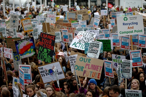 Demonstrators take part in a protest against climate change