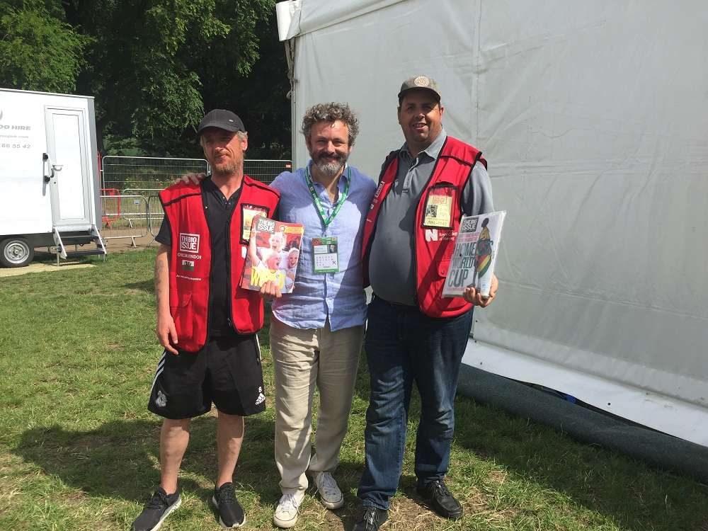 Michael Sheen with Big Issue vendors. [Courtesy of The Big Issue (UK)]