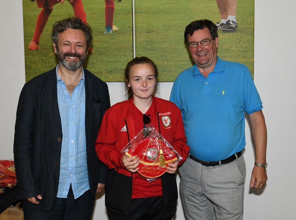 This year's captain of the Wales Homeless World Cup women's team, Reanna Walker, receiving her official cap