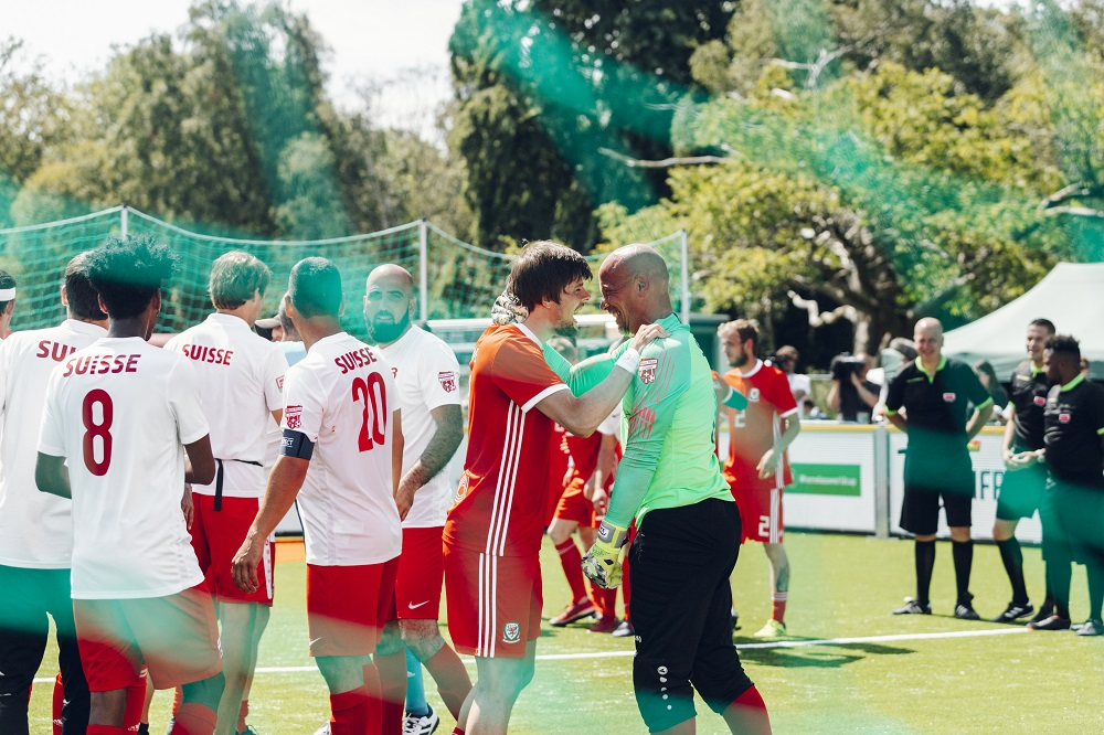 The Swiss team (left) after conceding a goal to host nation Wales. [Credit: Homeless World Cup / Mile 44 (www.milefortyfour.com]