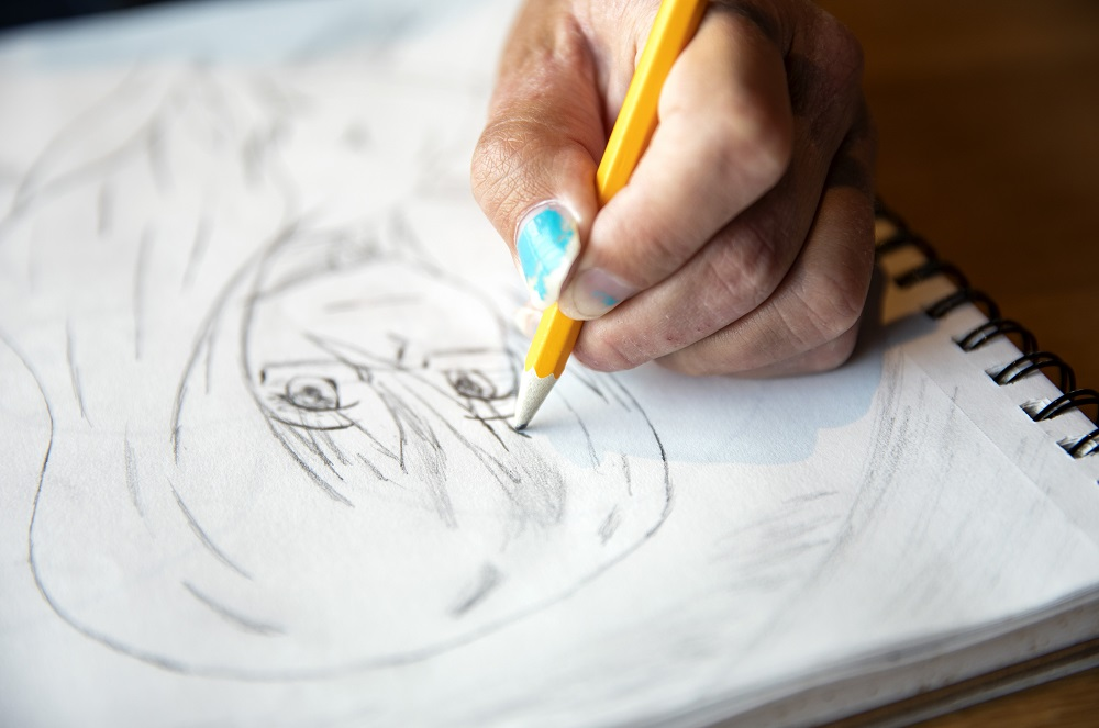 Rin adds details to a recent sketch. She also has a passion for graphic design, computer animation and video games. [Credit: Nathan Poppe]