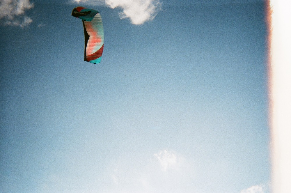 A kite surfer catches a breeze near Stars and Stripes Park.