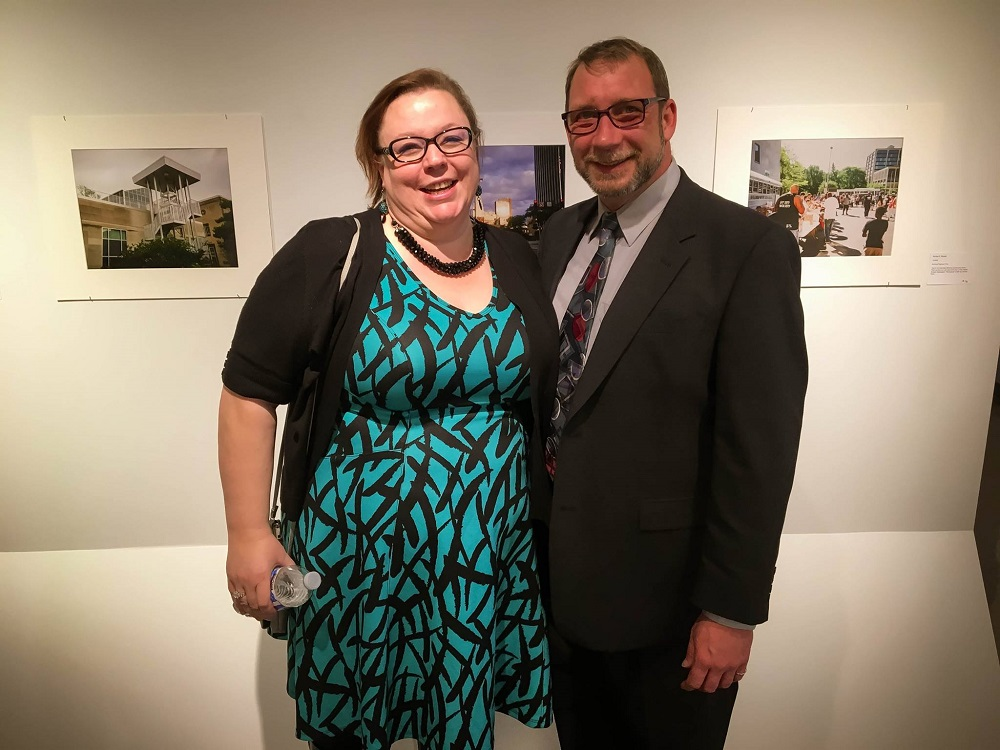 Amanda Faith Zuehlke, founder of Toledo Streets, with the street paper's current director John Keegan. [Photo courtesy of Toledo Streets]