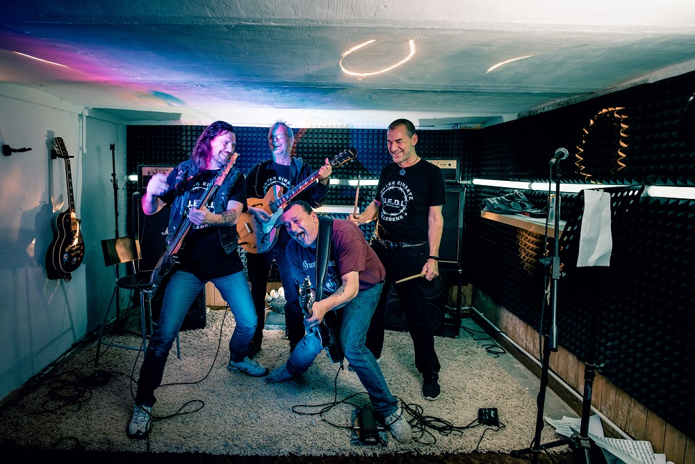 Striking the right pose: Golem, Jörg, Deerk and Duddi ( L to R) practising in the cellar of the cottage where Jörg and Golem live. [Credit: Mauricio Bustamante]
