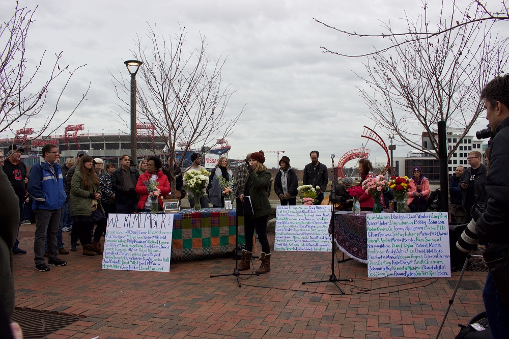 Pictures and flowers honor people who died while homeless in Nashville in 2019. [Credit: Hannah Herner]