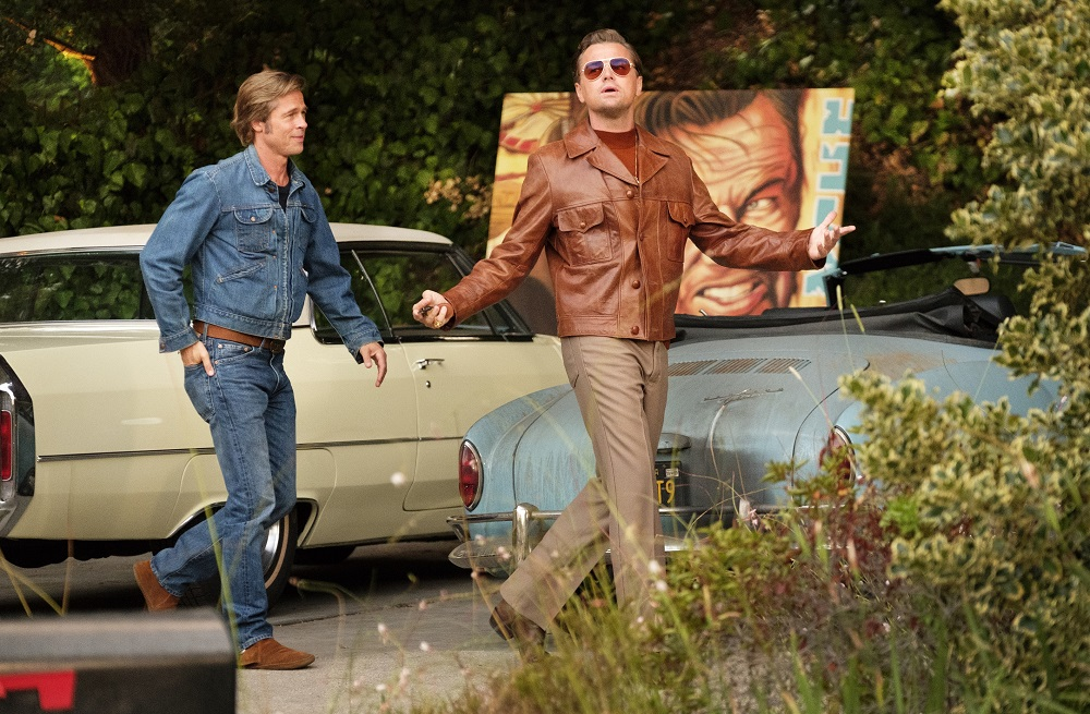 Brad Pitt (L) and Leonardo DiCaprio (R) in Once Upon A Time...In Hollywood. [Photo by Andrew Cooper]