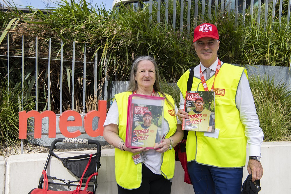 Big Issue Australia vendor Cheryl selling with Medibank CEO Craig Drummond. [Credit: Mark Avellino]