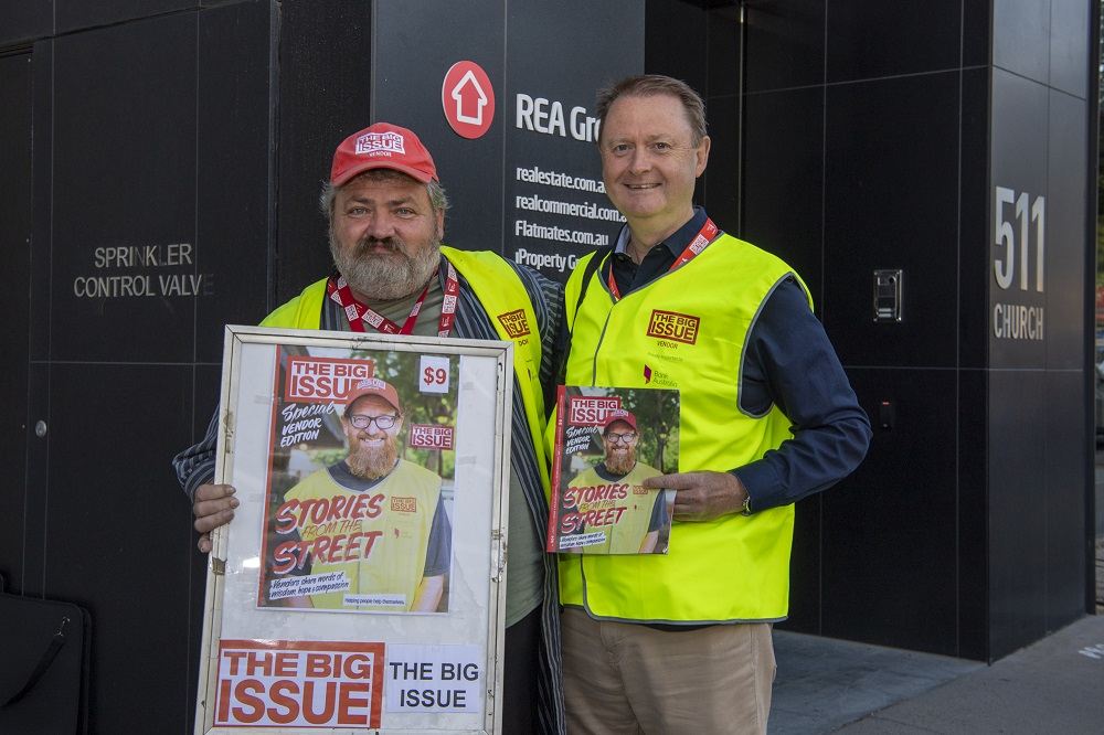 Big Issue Australia vendor Phil selling with REA CEO Owen Wilson. [Credit: Mark Avellino]
