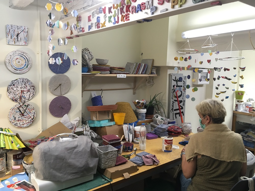 Shediart employee Christiane Fabrion in the process of creating Shediart products.