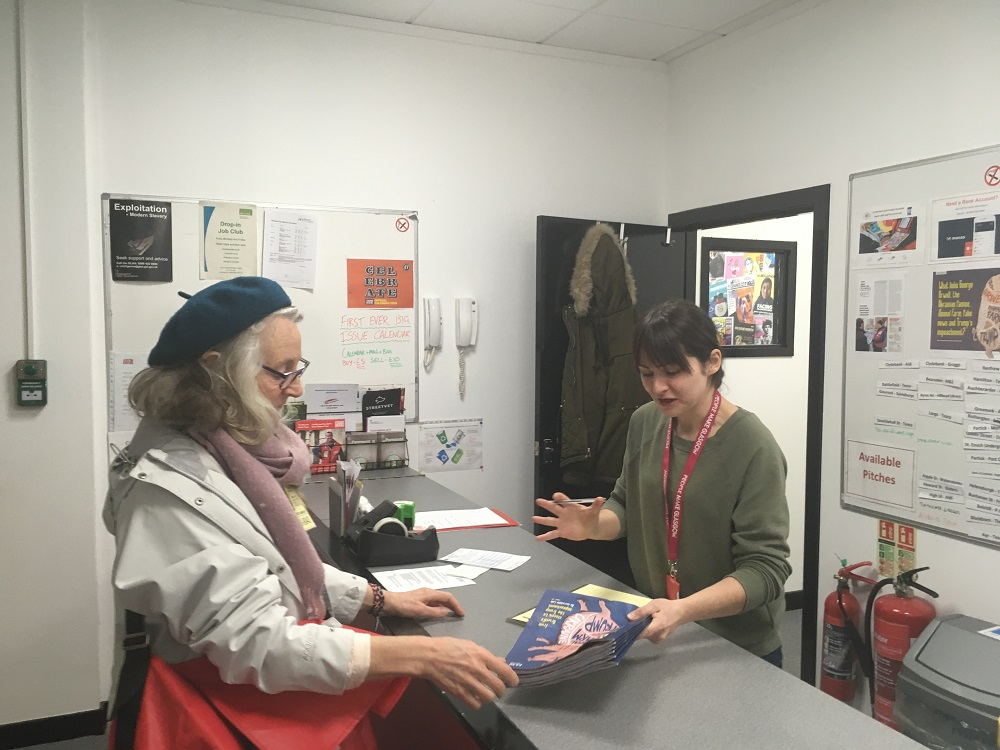 Anabel at The Big Issue distribution office collecting magazines.