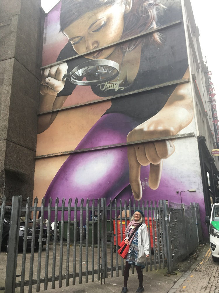 Anabel asked that we take a picture of her at the foot of her favourite Glasgow mural. Artwork like this is scattered across the city. Anabel likes this particular one as the woman depicted reminds her of her daughter.