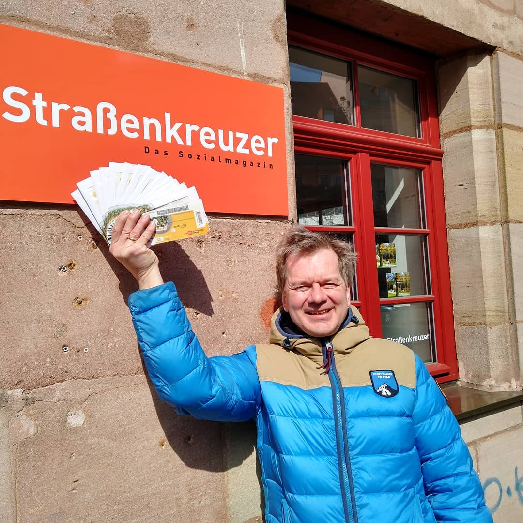 A Strassenkreuzer vendor receives shopping vouchers as part of a call to supermarket chains for assistance.