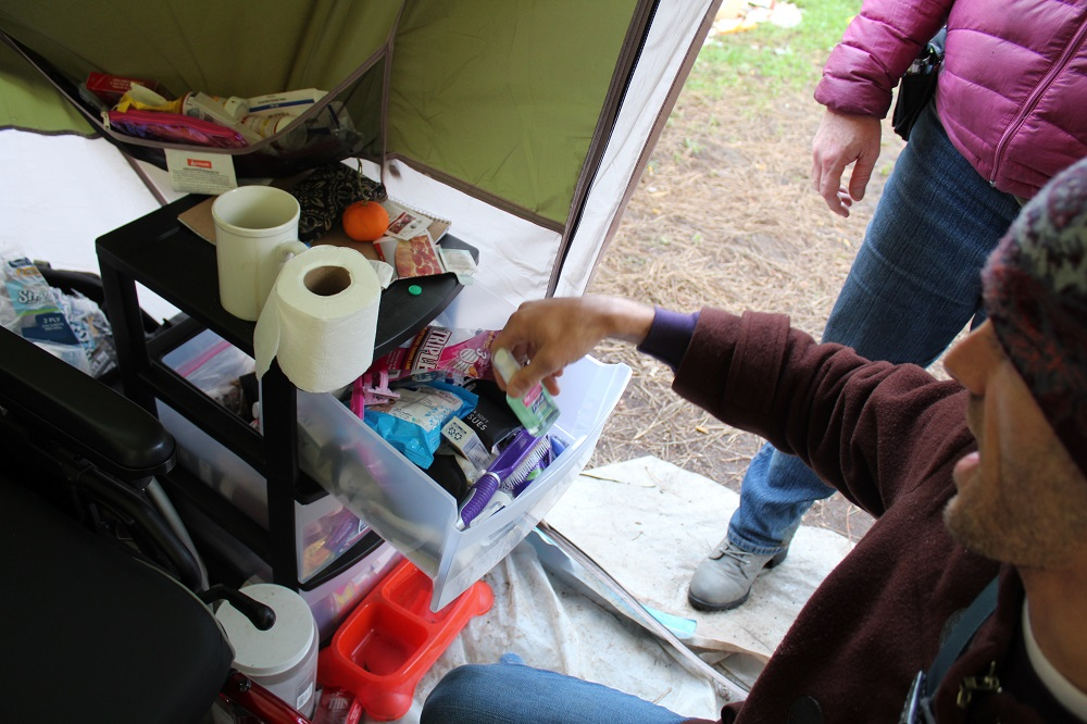 A medical tent that is part of a homeless camp in Portland is stocked with hygiene supplies. [Credit: Joanne Zuhl]