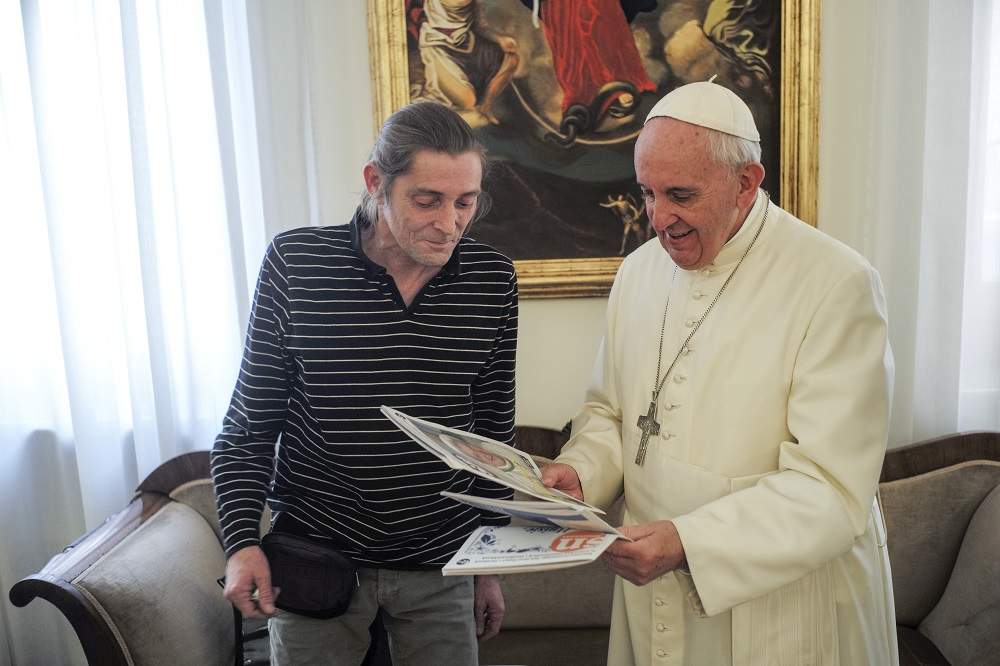In 2015, Pope Francis meets formerly homeless street paper Marc during an exclusive interview for street papers at the Vatican. Photo credit: Frank Dries, Straatnieuws / INSP